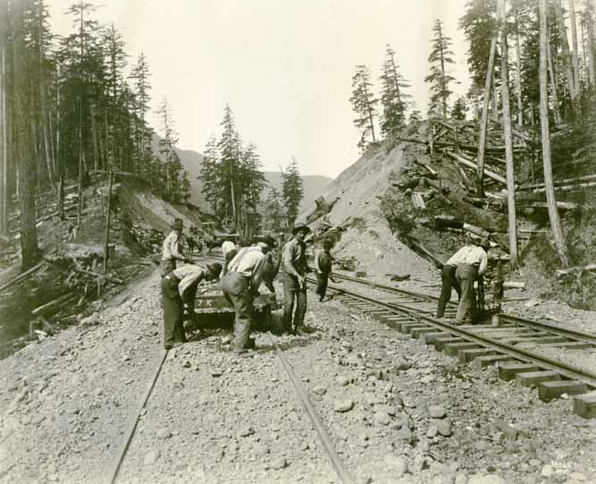 [logging railroad track with laborers]