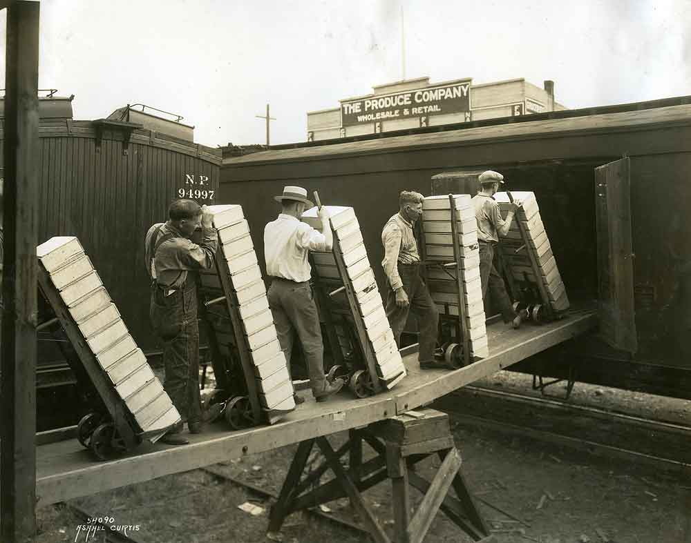 Men Loading Crates of Cherries into Railroad Car.