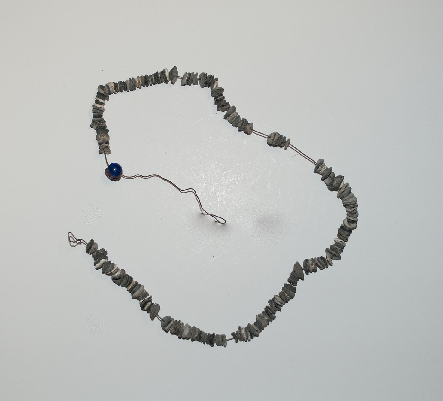 [string of shell disk beads]