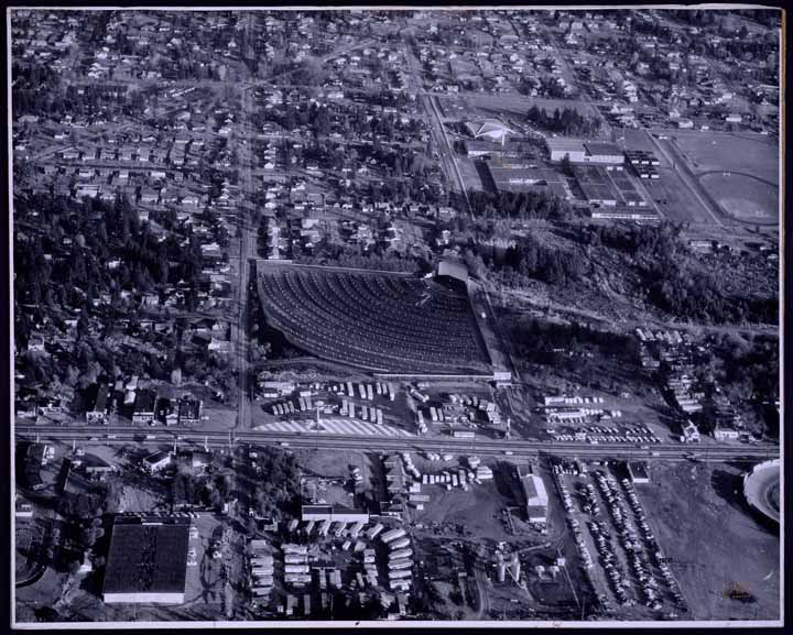 [Aerial photograph of the Aurora Drive-in, Ingraham High School, Pioneer Builders Supply Company Seattle, WA., in 1961]