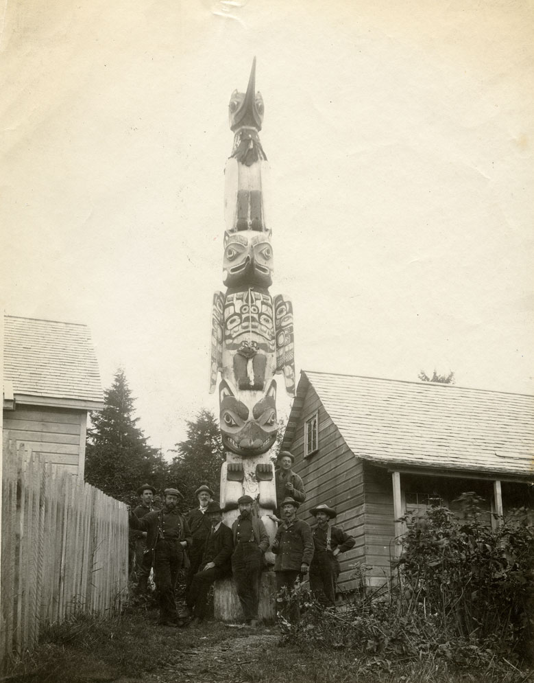 [Standing by totem pole at Fort Tongass, AK]
