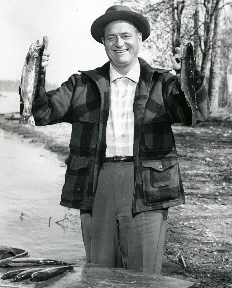 [Governor Rosellini catching fish]