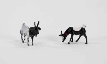[pair of toy goats for a Moravian Christmas putz]