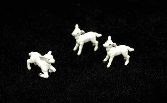 [set of toy lambs for a Moravian Christmas putz]