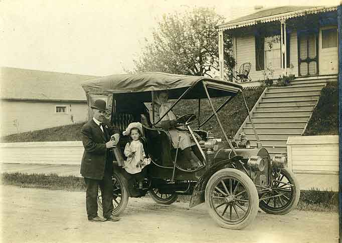 [Price Family by their Winton 6 automobile in front of Home]