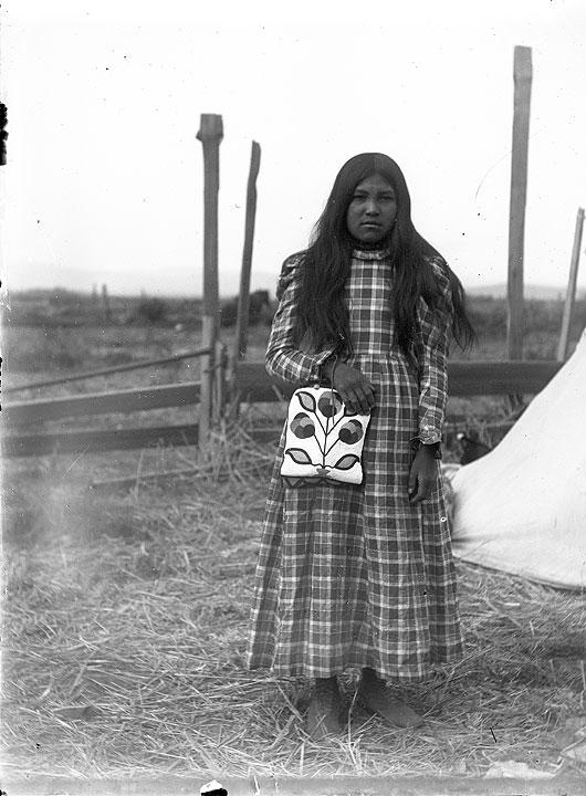 [Yakama woman with beaded bag]